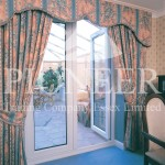 French door with curtain leading into conservatory