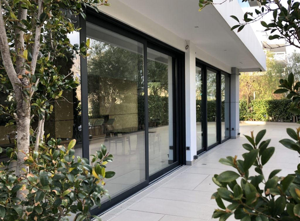two sets of aluminium sliding doors on a patio.